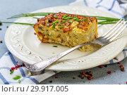 Piece of potato kugel on a plate. Стоковое фото, фотограф Марина Сапрунова / Фотобанк Лори