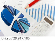 Купить «Калькулятор, графики, диаграммы и ручка. Бизнес-натюрморт», эксклюзивное фото № 29917185, снято 9 февраля 2019 г. (c) Юрий Морозов / Фотобанк Лори