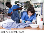 Купить «Female laundry worker during daily work», фото № 29917629, снято 15 января 2019 г. (c) Яков Филимонов / Фотобанк Лори