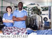 Купить «Two confident workers of dry cleaner», фото № 29917637, снято 15 января 2019 г. (c) Яков Филимонов / Фотобанк Лори