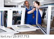 Купить «Foreman explaining plastic windows assembly process to young female worker», фото № 29917713, снято 19 июля 2017 г. (c) Яков Филимонов / Фотобанк Лори