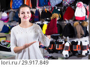 Купить «girl deciding on warm hat in sports store», фото № 29917849, снято 22 ноября 2016 г. (c) Яков Филимонов / Фотобанк Лори
