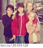Купить «four children play without parents on sidewalk in modern city», фото № 29919129, снято 21 октября 2017 г. (c) Яков Филимонов / Фотобанк Лори