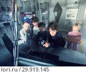 Купить «Children playing in bunker questroom», фото № 29919145, снято 21 октября 2017 г. (c) Яков Филимонов / Фотобанк Лори