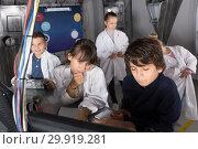 Купить «players solve riddles in the quest room bunker», фото № 29919281, снято 21 октября 2017 г. (c) Яков Филимонов / Фотобанк Лори