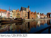 Купить «Embankment in historical part of Gdansk at sunny day, Poland», фото № 29919321, снято 13 мая 2018 г. (c) Яков Филимонов / Фотобанк Лори