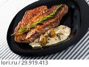 Купить «Grilled veal loin with mushroom sauce», фото № 29919413, снято 29 июня 2018 г. (c) Яков Филимонов / Фотобанк Лори