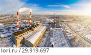 Купить «Power plant pipes on the background of the panorama of the winter city against blue sky», фото № 29919697, снято 8 декабря 2019 г. (c) Mikhail Starodubov / Фотобанк Лори