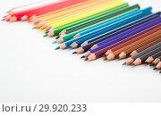 colored pencils lying in irregular row. Стоковое фото, фотограф Татьяна Яцевич / Фотобанк Лори