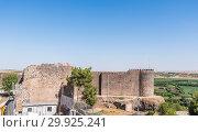 Купить «View of Keci Burcu(Goat Tower) and ancient walls of historical Diyarbakir's city walls in sur region in central of Diyarbakir,Turkey. 16 July 2018.», фото № 29925241, снято 16 июля 2018 г. (c) easy Fotostock / Фотобанк Лори