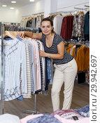 Купить «Woman shopping in clothing boutique», фото № 29942697, снято 10 октября 2018 г. (c) Яков Филимонов / Фотобанк Лори