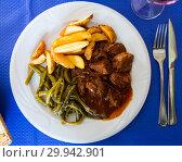 Купить «Top view of stewed beef with vegetables», фото № 29942901, снято 20 марта 2019 г. (c) Яков Филимонов / Фотобанк Лори