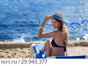 Купить «Beautiful woman sunbathing on a beach at tropical travel resort, enjoying summer holidays. Young woman lying on sun lounger near the sea. Happy serene woman», фото № 29943377, снято 9 февраля 2019 г. (c) Happy Letters / Фотобанк Лори
