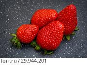 Купить «Ягоды клубники на чёрном фоне», эксклюзивное фото № 29944201, снято 10 февраля 2019 г. (c) Dmitry29 / Фотобанк Лори