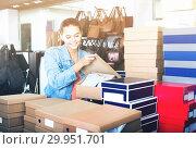 Купить «girl with carton packages in bags shop», фото № 29951701, снято 15 сентября 2016 г. (c) Яков Филимонов / Фотобанк Лори