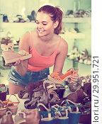 Купить «girl choosing pair of shoes in boutique», фото № 29951721, снято 15 сентября 2016 г. (c) Яков Филимонов / Фотобанк Лори
