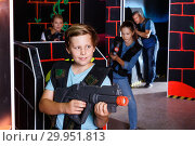 Купить «Excited boy aiming laser gun at other players during laser tag game in dark room», фото № 29951813, снято 3 сентября 2018 г. (c) Яков Филимонов / Фотобанк Лори