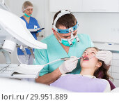 Купить «Male dentist performing treatment to girl», фото № 29951889, снято 1 марта 2018 г. (c) Яков Филимонов / Фотобанк Лори