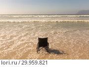 Купить «Wheelchair at seashore on the beach», фото № 29959821, снято 14 ноября 2018 г. (c) Wavebreak Media / Фотобанк Лори