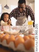 Купить «African American father and daughter baking cookies in kitchen», фото № 29960205, снято 7 ноября 2018 г. (c) Wavebreak Media / Фотобанк Лори