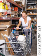 Купить «Female with purchases in build store», фото № 29961221, снято 20 сентября 2018 г. (c) Яков Филимонов / Фотобанк Лори