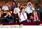 Купить «Group watching movie night for horror», фото № 29961481, снято 3 декабря 2016 г. (c) Яков Филимонов / Фотобанк Лори