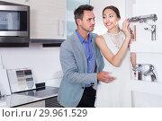 Купить «Portrait of smiling family choosing faucet for kitchen», фото № 29961529, снято 15 июня 2017 г. (c) Яков Филимонов / Фотобанк Лори