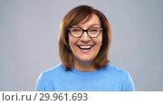 Купить «portrait of happy senior woman in glasses», видеоролик № 29961693, снято 11 февраля 2019 г. (c) Syda Productions / Фотобанк Лори