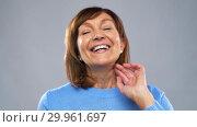 Купить «portrait of happy senior woman laughing», видеоролик № 29961697, снято 11 февраля 2019 г. (c) Syda Productions / Фотобанк Лори