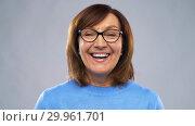 Купить «portrait of happy senior woman putting glasses on», видеоролик № 29961701, снято 11 февраля 2019 г. (c) Syda Productions / Фотобанк Лори