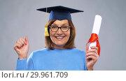 Купить «happy senior graduate student woman with diploma», видеоролик № 29961709, снято 11 февраля 2019 г. (c) Syda Productions / Фотобанк Лори