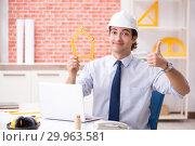 Купить «Construction supervisor working on blueprints», фото № 29963581, снято 13 сентября 2018 г. (c) Elnur / Фотобанк Лори