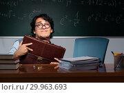 Купить «Young math teacher in front of chalkboard», фото № 29963693, снято 25 октября 2018 г. (c) Elnur / Фотобанк Лори