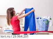 Купить «Young beautiful woman ironing at home», фото № 29964201, снято 30 октября 2018 г. (c) Elnur / Фотобанк Лори