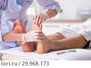 Купить «Podiatrist treating feet during procedure», фото № 29968173, снято 29 августа 2018 г. (c) Elnur / Фотобанк Лори