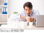 Купить «Young employee addicted to coffee», фото № 29968789, снято 26 июля 2018 г. (c) Elnur / Фотобанк Лори