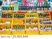 Купить «Russia, Samara, January 2019: a large selection of alcoholic beverages on the shelves of the supermarket. Text on russian: action, rum, tequila, captain», фото № 29969849, снято 22 января 2019 г. (c) Акиньшин Владимир / Фотобанк Лори