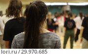 Купить «People on the open lesson indoors. Dancing class. Girl with dark hair», видеоролик № 29970685, снято 16 февраля 2019 г. (c) Константин Шишкин / Фотобанк Лори