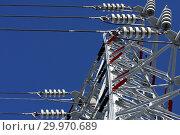 Купить «Опора ЛЭП с высоковольтными проводами на фоне голубого неба», фото № 29970689, снято 30 января 2010 г. (c) Александр Гаценко / Фотобанк Лори