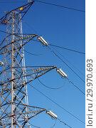 Купить «Опора ЛЭП с высоковольтными проводами на фоне голубого неба», фото № 29970693, снято 30 января 2010 г. (c) Александр Гаценко / Фотобанк Лори