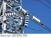 Купить «Опора ЛЭП с высоковольтными проводами на фоне голубого неба», фото № 29970701, снято 30 января 2010 г. (c) Александр Гаценко / Фотобанк Лори
