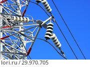 Купить «Опора ЛЭП с высоковольтными проводами на фоне голубого неба», фото № 29970705, снято 28 февраля 2010 г. (c) Александр Гаценко / Фотобанк Лори