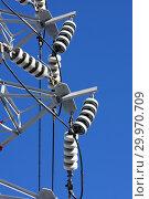Купить «Опора ЛЭП с высоковольтными проводами на фоне голубого неба», фото № 29970709, снято 30 января 2010 г. (c) Александр Гаценко / Фотобанк Лори