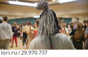 Купить «Active group dances. A woman with grey african braids», видеоролик № 29970737, снято 16 февраля 2019 г. (c) Константин Шишкин / Фотобанк Лори