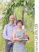 Купить «Beautiful elegant middle-aged couple posing smiling at a holiday.», фото № 29976129, снято 18 мая 2018 г. (c) Акиньшин Владимир / Фотобанк Лори