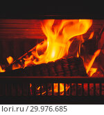 Купить «Firewood burns in fireplace, square», фото № 29976685, снято 26 января 2019 г. (c) EugeneSergeev / Фотобанк Лори