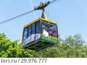 Купить «Sochi, Russia - June 5. 2018. People in cable car in the Arboretum», фото № 29976777, снято 5 июня 2018 г. (c) Володина Ольга / Фотобанк Лори