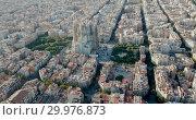 Купить «Aerial view of cityscape of Barcelona, Eixample district and Sagrada Familia», видеоролик № 29976873, снято 16 ноября 2018 г. (c) Яков Филимонов / Фотобанк Лори