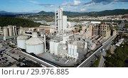 Купить «View from drone of cement plant industrial area, Catalonia, Spain», видеоролик № 29976885, снято 25 декабря 2018 г. (c) Яков Филимонов / Фотобанк Лори