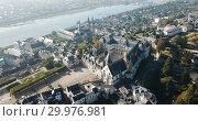 Купить «View from drone of French city of Blois with Royal Chateau and church of St. Nicolas in sunny autumn day», видеоролик № 29976981, снято 25 октября 2018 г. (c) Яков Филимонов / Фотобанк Лори